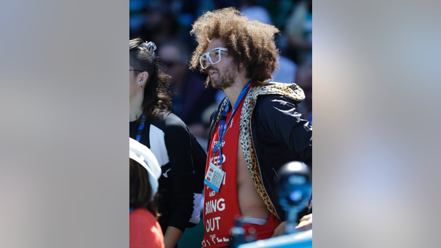 American rapper Redfoo, watches the quarterfinal between Victoria Azarenka of Belarus and Russia's Svetlana Kuznetsova at the Australian Open tennis championship in Melbourne, Australia, Wednesday, Jan. 23, 2013. (AP Photo/Andy Wong)