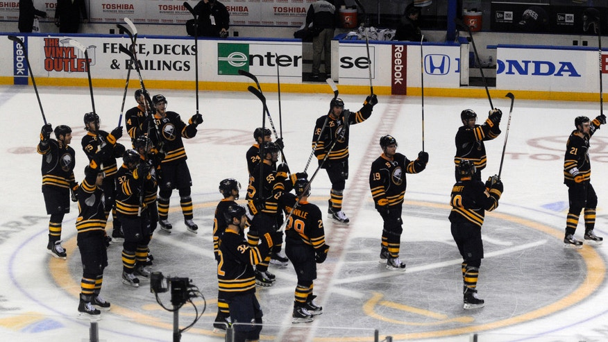 Buffalo Sabres salute their fans at center ice following a 5-2 victory over the Philadelphia Flyers during the season opener NHL hockey game in Buffalo, N.Y., Sunday, Jan. 20, 2013. (AP Photo/Gary Wiepert)
