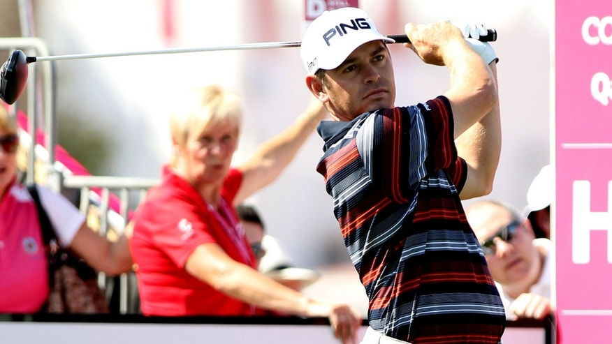 Louis Oosthuizen of South Africa plays his second shot on the 1 hole during the first round of the Commercial Bank Qatar Masters held at Doha Golf Club in Qatar ,Wednesday, Jan. 23, 2013. (AP Photo/Osama Faisal)