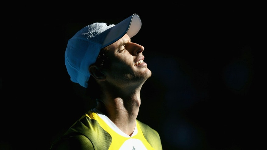 Britain's Andy Murray reacts during his quarterfinal match against France's Jeremy Chardy at the Australian Open tennis championship in Melbourne, Australia, Wednesday, Jan. 23, 2013. (AP Photo/ Cameron Spencer ,Pool)
