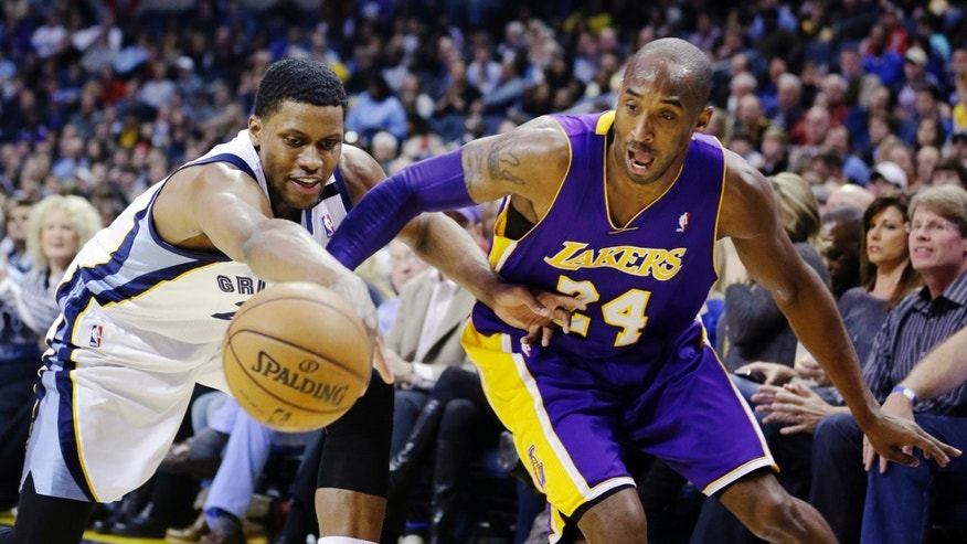 Memphis Grizzlies' Rudy Gay, left, and Los Angeles Lakers' Kobe Bryant (24) battle for a loose ball during first half of an NBA basketball game in Memphis, Tenn., Wednesday, Jan. 23, 2013. (AP Photo/Daniel Johnston)