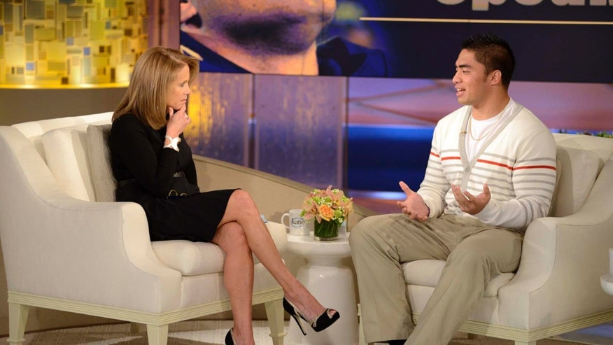 "This Jan. 22, 2013 photo released by ABC Notre Dame linebacker Manti Te'o, right, speaking with host Katie Couric during an interview for ""Katie,"" in New York. The interview will air on Thursday, Jan. 24."