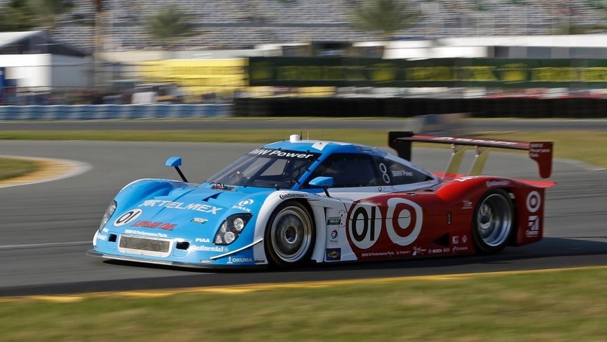 Scott Pruett drives the Ganassi Racing BMW Riley to win the pole position during qualifying for the Rolex 24 hour auto race at Daytona International Speedway, Thursday, Jan. 24, 2013, in Daytona Beach, Fla. (AP Photo/John Raoux)