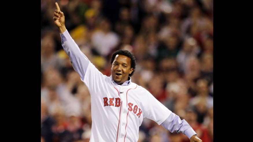FILE - In this April 4, 2010, file photo, former Boston Red Sox pitcher Pedro Martinez reacts after throwing the ceremonial first pitch before the Red Sox opening game of the baseball season against the New York Yankees in Boston. Martinez, a three-time Cy Young Award winner and eight-time All-Star, who spent seven seasons in Boston, was brought back to the franchise to serve as a special assistant to general manager Ben Cherington, the team announced, Thursday, Jan. 24, 2013. (AP Photo/Charles Krupa, File)