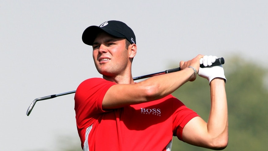 Martin Kaymer of Germany plays his shot on the 18th  hole during the Second  round of the Commercial Bank Qatar Masters held at the Doha Golf Club in Qatar, Thursday, Jan. 24, 2013. (AP Photo/Osama Faisal)
