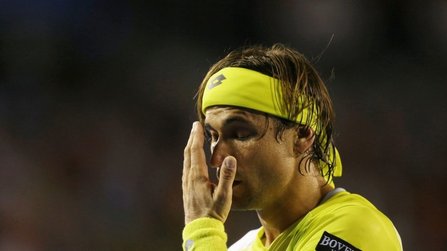 Spain's David Ferrer reacts during his semifinal loss to Serbia's Novak Djokovic at the Australian Open tennis championship in Melbourne, Australia, Thursday, Jan. 24, 2013. (AP Photo/Quinn Rooney,Pool)