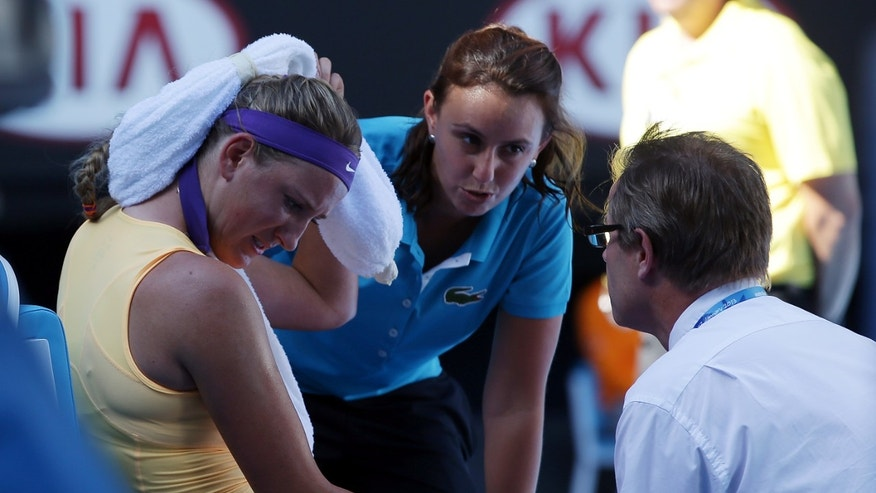 Victoria Azarenka of Belarus receives treatment during her semifinal match against Sloane Stephens of the US at the Australian Open tennis championship in Melbourne, Australia, Thursday, Jan. 24, 2013. (AP Photo/Aaron Favila)