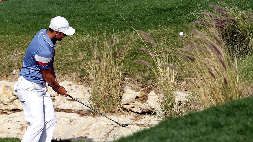 Martin Kaymer of Germany plays his shot on the 11th hole during the third round of the Commercial Bank Qatar Masters held at the Doha Golf Club in Qatar, Friday, Jan. 25, 2013. (AP Photo/Osama Faisal)