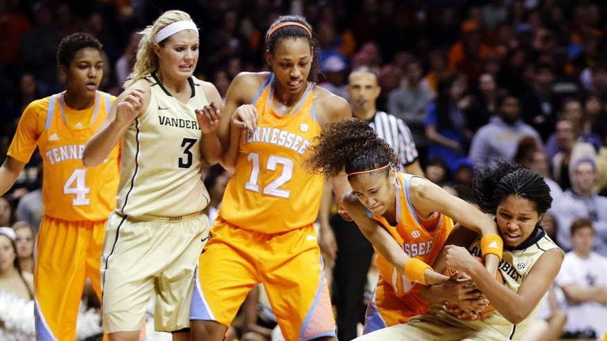 Tennessee guard Meighan Simmons, second from right, struggles for control of the ball with Vanderbilt guard Morgan Batey, right, in the first half of an NCAA college basketball game, Thursday, Jan. 24, 2013, in Nashville, Tenn. Watching are Tennessee guard Kamiko Williams (4), Vanderbilt forward Heather Bowe (3) and Tennessee's Bashaara Graves (12). (AP Photo/Mark Humphrey)