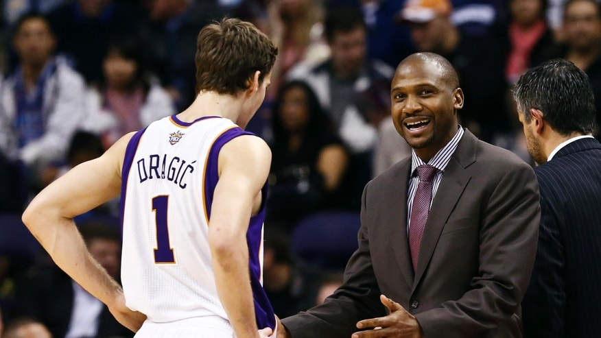 Phoenix Suns interim head coach Lindsey Hunter, right, talks with Goran Dragic (1), of Slovenia, during the first half in an NBA basketball game against the Los Angeles Clippers, Thursday, Jan. 24, 2013, in Phoenix. (AP Photo/Ross D. Franklin)