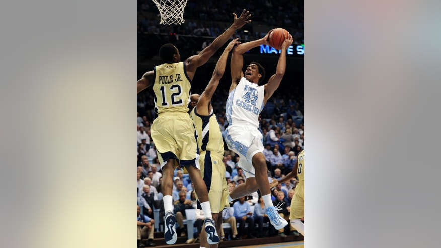 North Carolina's James Michael McAdoo (43) shoots as Georgia Tech's Stacey Poole Jr. (12) and Kammeon Holsey defend during the first half of an NCAA college basketball game in Chapel Hill, N.C., Wednesday, Jan. 23, 2013. (AP Photo/Gerry Broome)