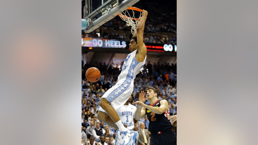North Carolina's James Michael McAdoo dunks over Maryland's Logan Aronhalt (2) during the second half of an NCAA college basketball game in Chapel Hill, N.C., Saturday, Jan. 19, 2013. North Carolina won 62-52. (AP Photo/Gerry Broome)