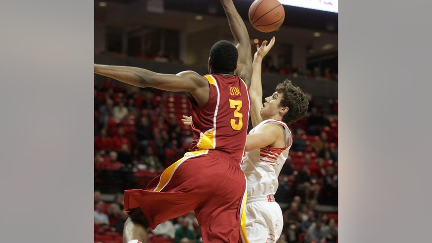 In this photo taken, Wednesday, Jan. 23, 2013, Texas Tech's Dusty Hannahs, right, shoots against Iowa State's Melvin Ejim (3) during anheir NCAA college basketball game in Lubbock, Texas. Hannahs has made an immediate impact during his freshman season. (AP Photo/Lubbock Avalanche-Journal, Stephen Spillman) LOCAL TV OUT