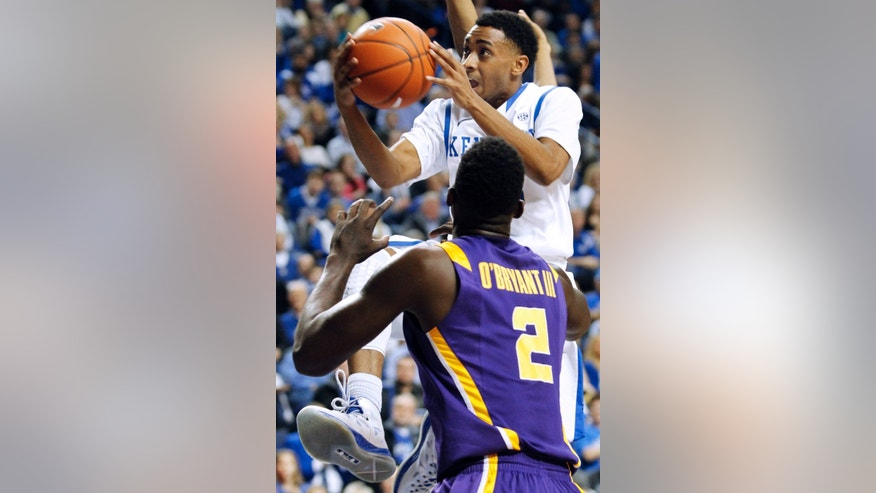 Kentucky's Ryan Harrow, top, looks for a shot over LSU's Johnny O'Bryant III (2) during the first half of an NCAA college basketball game at Rupp Arena in Lexington, Ky., Saturday, Jan. 26, 2013. (AP Photo/James Crisp)