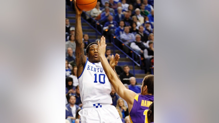 Kentucky's Archie Goodwin (10) shoots under pressure from LSU's Shane Hammink during the first half of an NCAA college basketball game at Rupp Arena in Lexington, Ky., Saturday, Jan. 26, 2013. (AP Photo/James Crisp)