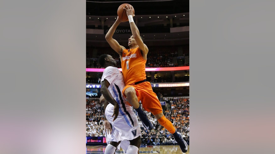 Syracuse's Michael Carter-Williams, right, goes up for a shot against Villanova's JayVaughn Pinkston during the first half of an NCAA college basketball game, Saturday, Jan. 26, 2013, in Philadelphia. (AP Photo/Matt Slocum)