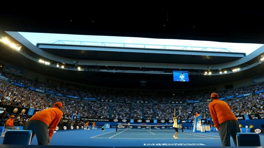 Victoria Azarenka of Belarus serves to China's Li Na in the women's final at the Australian Open tennis championship in Melbourne, Australia, Saturday, Jan. 26, 2013. (AP Photo/Ryan Pierse,Pool)