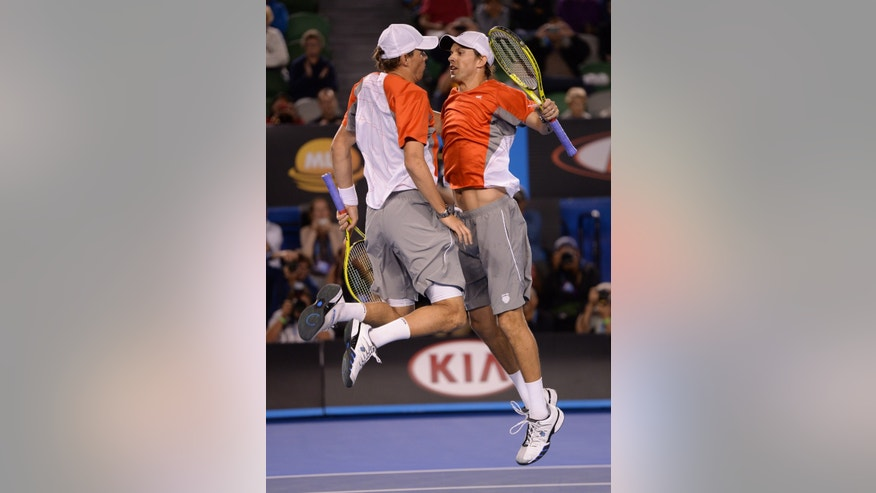 Bob and Mike Bryan of the US celebrate after defeating RobinHaase and Igor Sijsling of the Netherlands in the men's doubles final at the Australian Open tennis championship in Melbourne, Australia, Sunday, Jan. 27, 2013. (AP Photo/Andrew Brownbill)