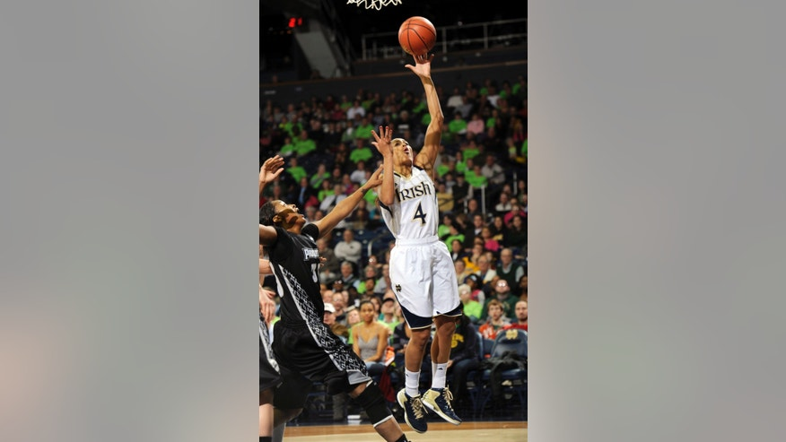 Notre Dame guard Skylar Diggins (4) shoots over Providence forward Brianna Edwards in the first half of an NCAA college basketball game, Saturday, Jan. 26, 2013, in South Bend, Ind. (AP Photo/Joe Raymond)
