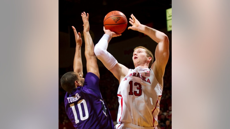 Nebraska's Brandon Ubel (13) shoots over Northwestern's Mike Turner (10) during the first half of their NCAA college basketball game, Saturday, Jan. 26, 2013, in Lincoln, Neb. (AP Photo/The Journal-Star, Matt Ryerson) LOCAL TV OUT&#x3b; KOLN-TV OUT&#x3b; KGIN-TV OUT&#x3b; KLKN-TV OUT