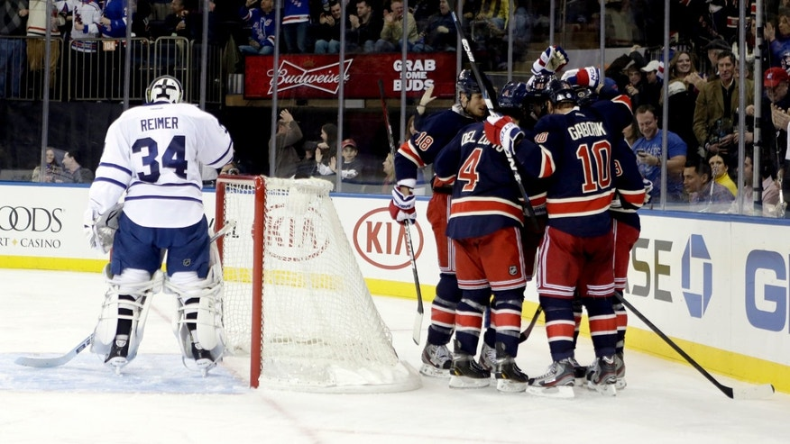Toronto Maple Leafs goalie James Reimer (34) reacts as the New York Rangers celebrate a goal by Brad Richards during the second period of an NHL hockey game, Saturday, Jan. 26, 2013, in New York. (AP Photo/Frank Franklin II)