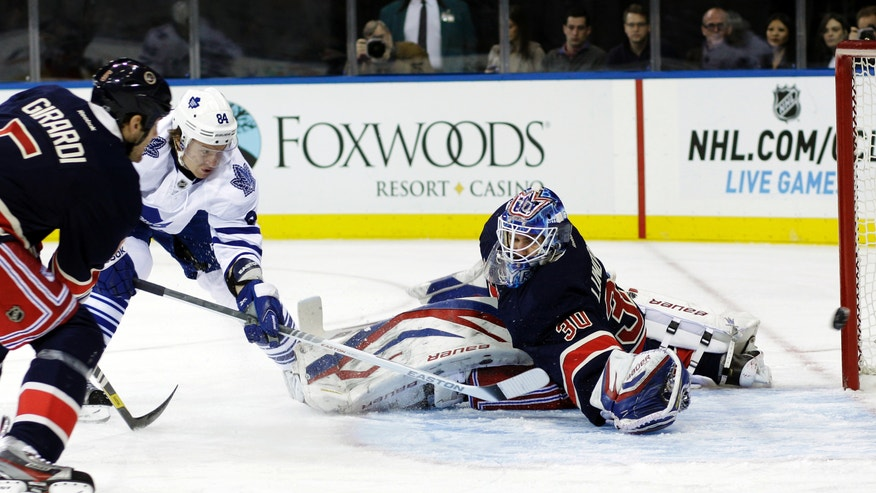 Toronto Maple Leafs' Mikhail Grabovski (84), of Germany, shoots the puck past New York Rangers goalie Henrik Lundqvist, of Sweden, during the first period of an NHL hockey game, Saturday, Jan. 26, 2013, in New York. (AP Photo/Frank Franklin II)