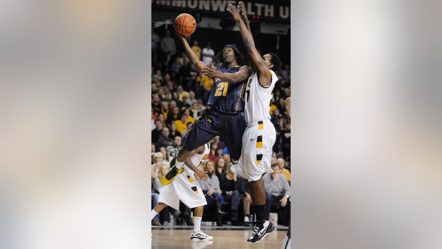 La Salle's Tyrone Garland shoots next to Virginia Commonwealth's Treveon Graham during the first half of an NCAA college basketball game Saturday, Jan. 26, 2013, in Richmond, Va. (AP Photo/Clement Britt)