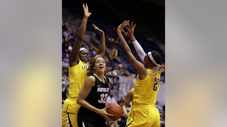 Colorado's Arielle Roberson (32) looks to shoot between California's Talia Caldwell, left, and Reshanda Gray (21) in the first half of an NCAA college basketball game Friday, Jan. 25, 2013, in Berkeley, Calif. (AP Photo/Ben Margot)