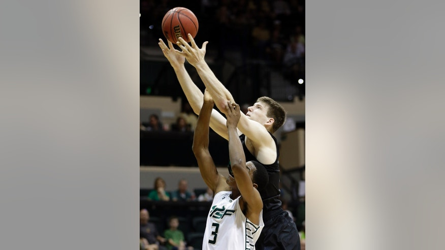 Notre Dame forward Jack Cooley (45) fouls South Florida forward Zach LeDay (3) as he attempts to grab a rebound during the first half of an NCAA college basketball game Saturday, Jan. 26, 2013, in Tampa, Fla. (AP Photo/Chris O'Meara)