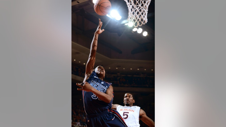 Mississippis's Jarvis Summer shoots around Auburn's Shaquille Johnson in the first half of their NCAA college basketball game on Saturday, Jan. 19, 2013 in Auburn, Ala. (AP Photo/Todd J. Van Emst)