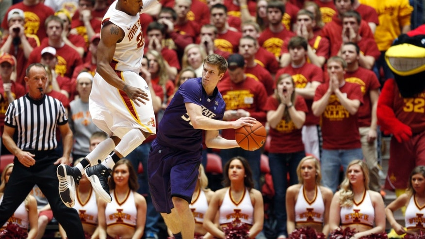 Iowa State guard Tyrus McGee, left, defends against Kansas State guard Will Spradling, right, during the second half of an NCAA college basketball game, Saturday, Jan. 26, 2013, in Ames, Iowa. Iowa State won 73-67. (AP Photo/Matthew Putney)