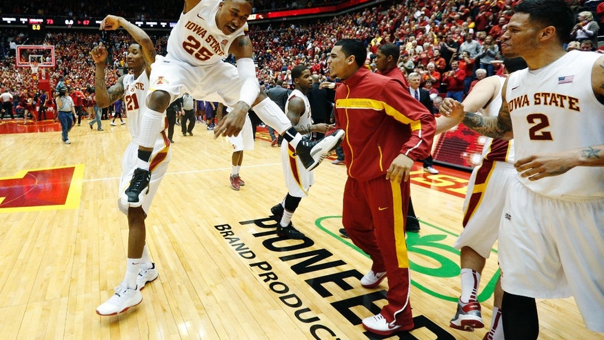 Iowa State guard Will Clyburn 921) and Tyrus McGee (25) celebrate as guard Chris Babb (2) moves to join following their 73-67 win over Kansas State in an NCAA college basketball game, Saturday, Jan. 26, 2013, in Ames, Iowa. (AP Photo/Matthew Putney)