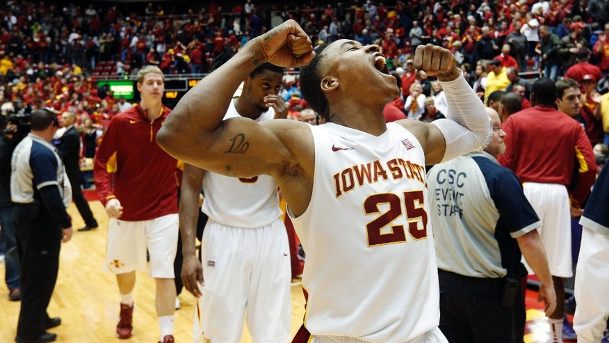 Iowa State guard Tyrus McGee (25) celebrates their 73-67 win over Kansas State in an NCAA college basketball game, Saturday, Jan. 26, 2013, in Ames, Iowa. (AP Photo/Matthew Putney)