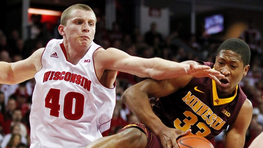 Minnesota's Rodney Williams (33) pulls in an offensive rebound against Wisconsin's Jared Bergrren (40) during the first half of an NCAA college basketball game, Saturday, Jan. 26, 2013, in Madison, Wis. (AP Photo/Andy Manis)