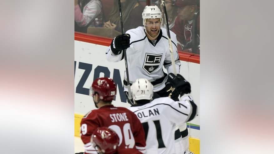 Los Angeles Kings center Jeff Carter (77) celebrates after scoring against the Phoenix Coyotes in the second period during an NHL hockey game Saturday, Jan. 26, 2013, in Glendale, Ariz. (AP Photo/Rick Scuteri)