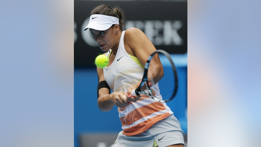 Croatia's Ana Konjuh makes a backhand return during the girl's singles final against Katerina Siniakova of the Czech Republic at the Australian Open tennis championship in Melbourne, Australia, Saturday, Jan. 26, 2013. (AP Photo/Aaron Favila)