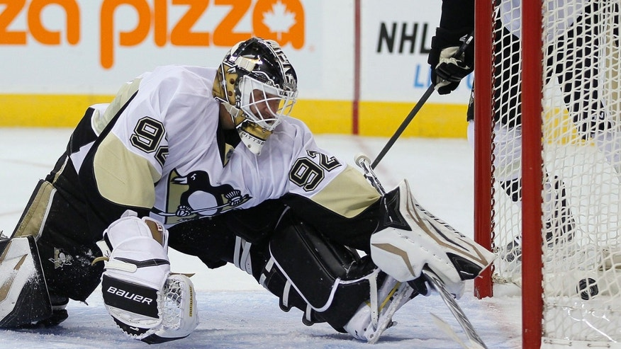 Pittsburgh Penguins' goaltender Tomas Vokoun (92) watches Winnipeg Jets' Andrew Ladd's shot blast past him during second-period NHL hockey game action in Winnipeg, Manitoba, Friday, Jan. 25, 2013. (AP Photo/The Canadian Press, John Woods)