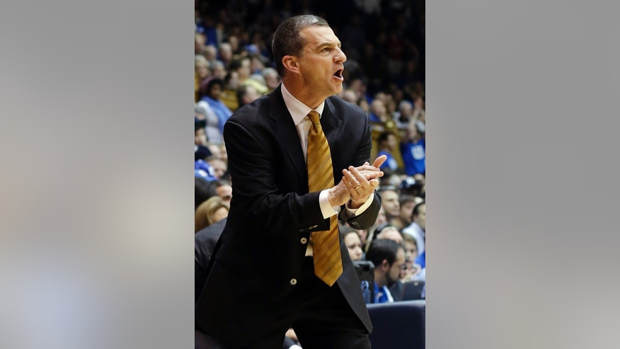 Maryland head coach Mark Turgeon directs his team during the first half of an NCAA college basketball game against Duke in Durham, N.C., Saturday, Jan. 26, 2013. Duke won 84-64. (AP Photo/Gerry Broome)