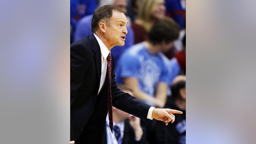 Oklahoma head coach Lon Kruger directs his team during the first half of an NCAA college basketball game against Kansas in Lawrence, Kan., Saturday, Jan. 26, 2013. (AP Photo/Orlin Wagner)