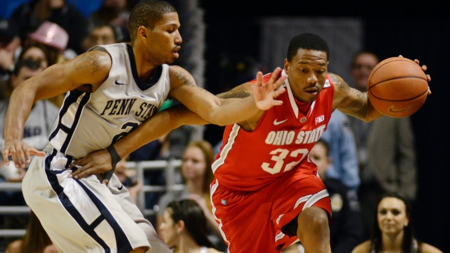 Ohio State's Lenzelle Smith Jr. (32) works past Penn State's D.J Newbill (2) during the first half of an NCAA college basketball game in State College, Pa., Saturday, Jan. 26, 2013. (AP Photo/Ralph Wilson)