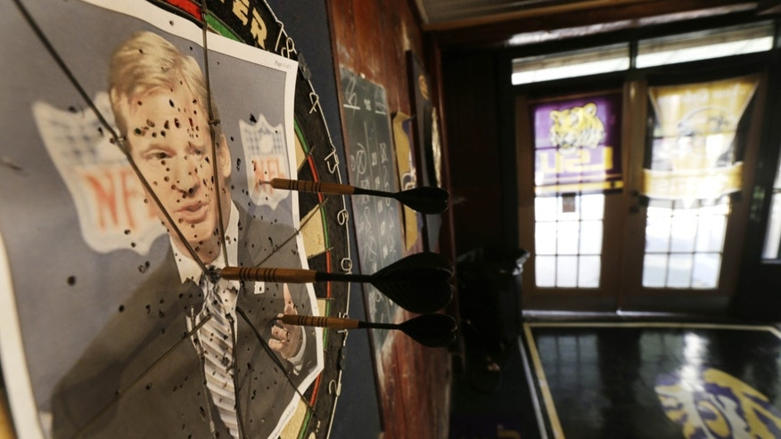 Jan. 25, 2013: A photo of NFL commissioner Roger Goodell is seen on a dartboard inside the Parkview Tavern in New Orleans.