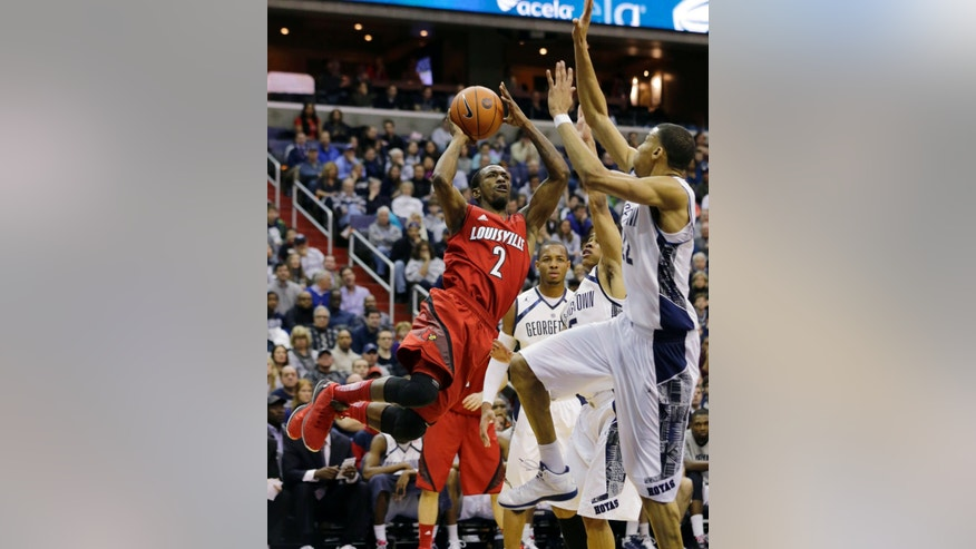 Louisville guard Russ Smith (2) shoots with Georgetown guard Jabril Trawick (55), guard Markel Starks (5) and forward Otto Porter Jr. (22) around him during the first half of an NCAA college basketball game, Saturday, Jan. 26, 2013, in Washington. (AP Photo/Alex Brandon)