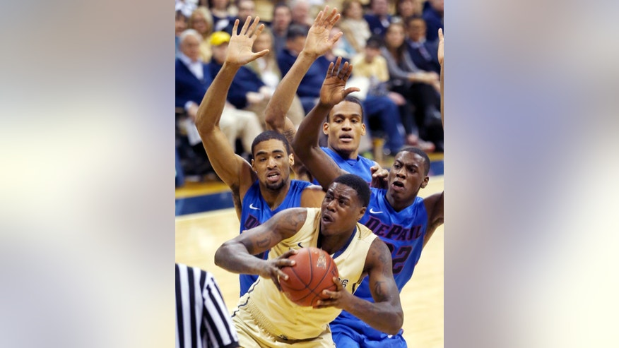 DePaul's Brandon Young, left, Cleveland Melvin, center, and Charles McKinney, right, all defend as Pittsburgh's Dante Taylor, bottom,  goes up for a shot in the first half of an NCAA college basketball game on Saturday, Jan. 26, 2013 in Pittsburgh. (AP Photo/Keith Srakocic)