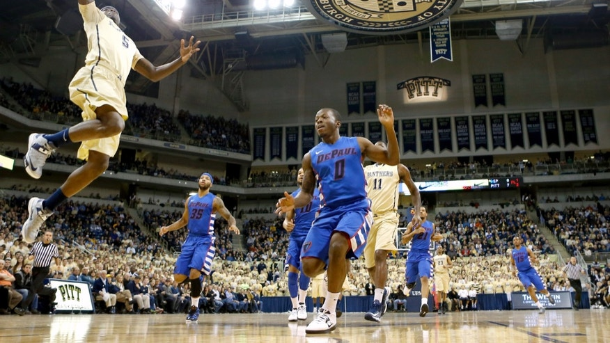 Pittsburgh's Durand Johnson (5) goes up for a dunk in front of DePaul's Worrel Clahar (0) in the first half of the NCAA college basketball game on Saturday, Jan. 26, 2013 in Pittsburgh. (AP Photo/Keith Srakocic)