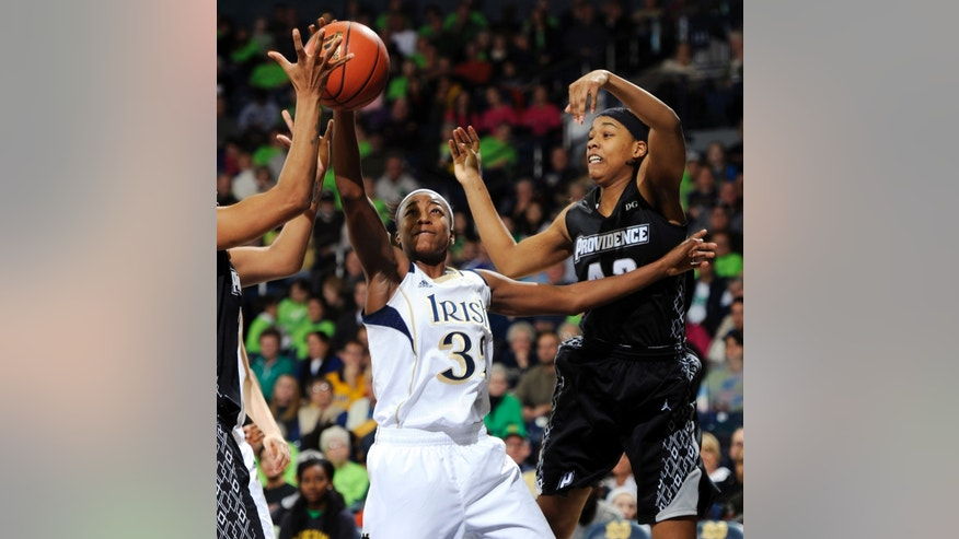 Notre Dame guard Jewell Loyd, left, and Providence forward Alexis Harris battle for a rebound in the first half of an NCAA college basketball game, Saturday, Jan. 26, 2013, in South Bend, Ind. (AP Photo/Joe Raymond)