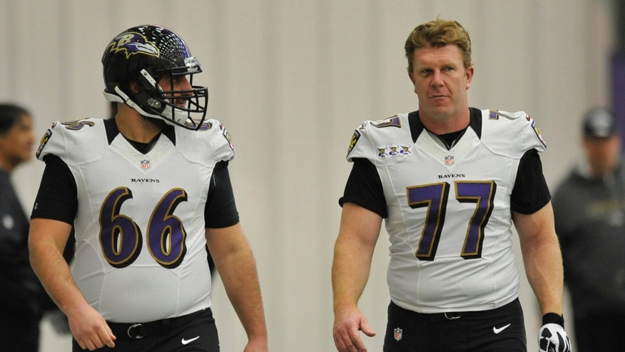 Baltimore Ravens Matt Birk, and Gino Gradkowski talk during football practice Saturday, Jan. 26, 2013 in Owings Mills, Md. (AP Photo/Gail Burton).