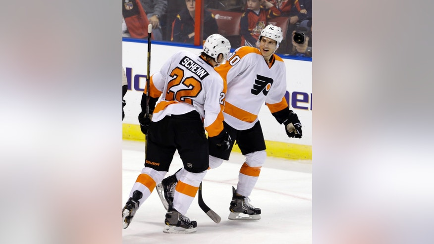 Philadelphia Flyers' Brayden Schenn (10) is congratulated by teammate Luke Schenn (22) after Brayden scored against the Florida Panthers during the second period of an NHL hockey game in Sunrise, Fla., Saturday, Jan. 26, 2013. (AP Photo/Alan Diaz)