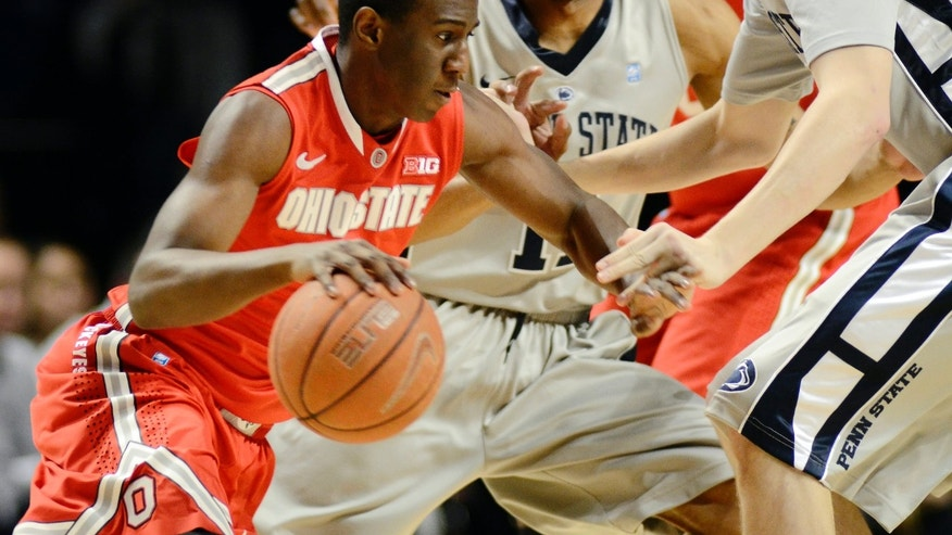 Ohio State's Shannon Scott, left, works past Penn State's Jermaine Marshall, center, and Patrick Ackerman during the first half of an NCAA college basketball game in State College, Pa., Saturday, Jan. 26, 2013. (AP Photo/Ralph Wilson)