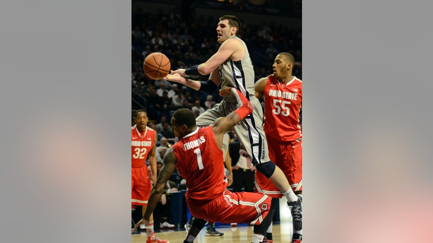 Penn State's Sasa Borovnjak (21) is fouled on the way to the basket by Ohio StateÌs Deshaun Thomas (1) during the first half of an NCAA college basketball game in State College, Pa., Saturday, Jan. 26, 2013. (AP Photo/Ralph Wilson)