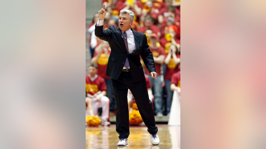 Kansas State head coach Bruce Weber directs his players during the first half of an NCAA college basketball game against Iowa State, Saturday, Jan. 26, 2013, in Ames, Iowa. (AP Photo/Matthew Putney)